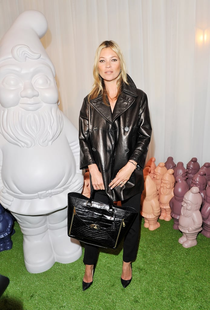 Kate Moss outfitted a slick leather trench with classic black trousers and pumps for her arrival at Mulberry in London.