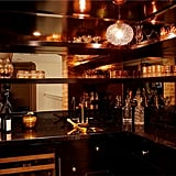 The midcentury-inspired wet bar is dark and sexy. We wonder if any of Lauren's castmates from The Hills have imbibed here.