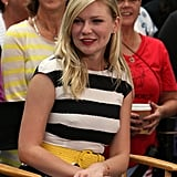Kirsten Dunst wore a striped dress with a yellow belt in NYC.