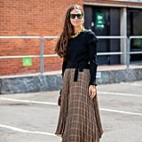 Autumn Outfit Idea: Black Jumper + Tartan Skirt + Heels