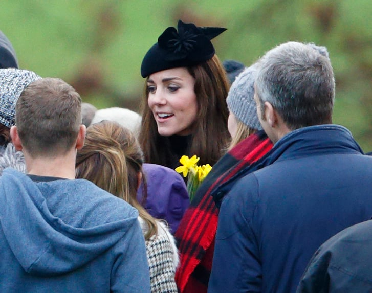 """The duchess topped off her Michael Kors Collection tweed set with her flower-adorned """"Fairy Tale"""" felt hat."""