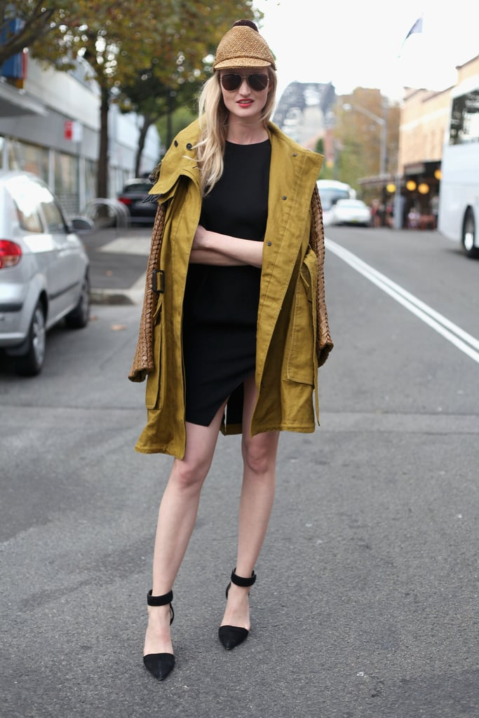 Street-style photographer Candice Lake rocked a cool woven jute hat with a minimalist LBD, ecru-coloured topper, and pointy ankle-strap heels.