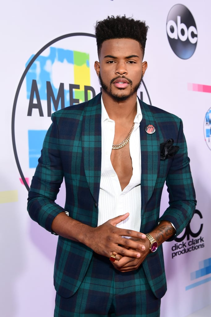 "Trevor Jackson is currently stealing hearts as Aaron Jackson on Freeform's college series Grown-ish, but quite a few people were initially hesitant to admit their crush on the former Disney actor. ""Trevor Jackson looks kinda hot. I feel like a cougar saying that,"" one person tweeted during show's premiere. ""Wait [Trevor] is how old?"" another person asked. We can confirm Trevor is 21 years old. He was born on Aug. 30, 1996, which means he's grown — no ish about it. It also means you're allowed to thirst over him without feeling guilty. We've rounded up 15 photos of Trevor being a walking hottie for your viewing pleasure ahead."