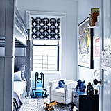 Son Gideon's room blends traditional RH Baby & Child furnishings with lively boyish touches, including a Flash Gordon lithograph and Keith Haring chair.