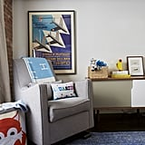 Two-year-old Sid's room is a wash of calming blues and grays. Within the color scheme is a cool vintage poster, the perfect nod to Jason and Jenny's love of art!