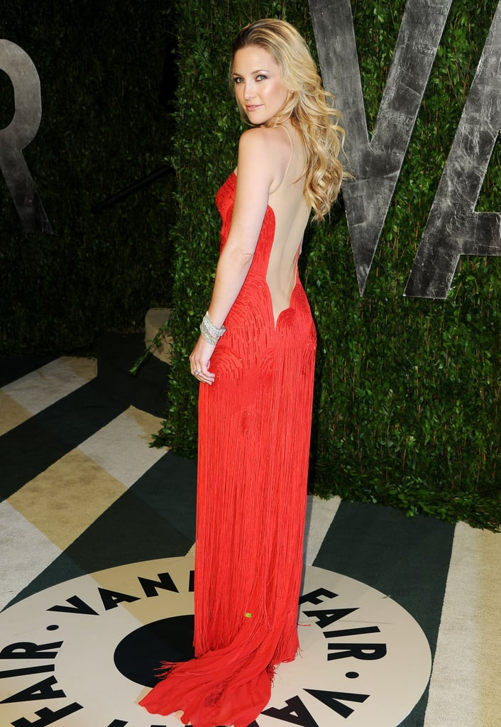 Wowza! Kate Hudson in vintage Versace, from the back.