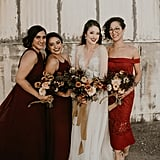This bride put her maid of honor in a red off-the-shoulder gown, while her two bridesmaids wore matching maroon dresses.