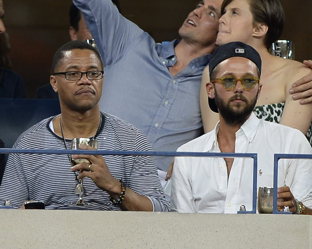 Cuba Gooding Jr. and designer Chris Benz sat side by side in the stands.