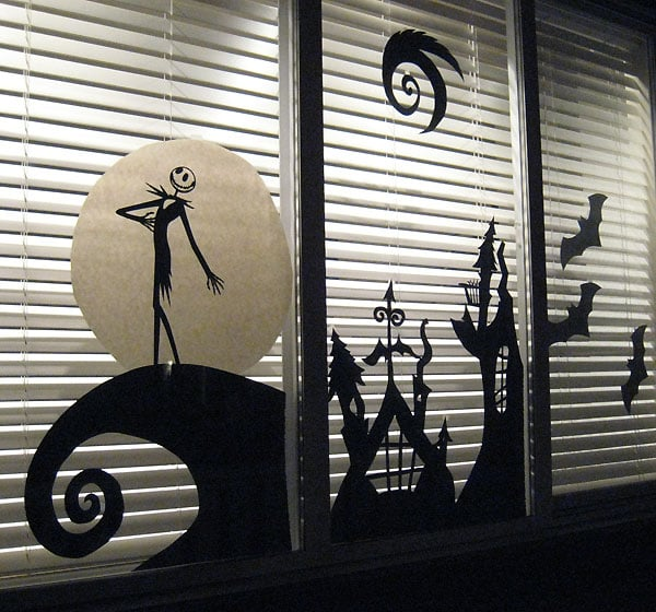 turn your windows into a scene from the nightmare before christmas using a silhouette machine and