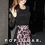 Miranda Kerr sported sunglasses at night.