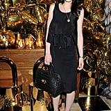 The Downton Abbey starlet donned all black at a Mulberry dinner in February — we love that she added a funky leopard-printed heel for a pop of texture.