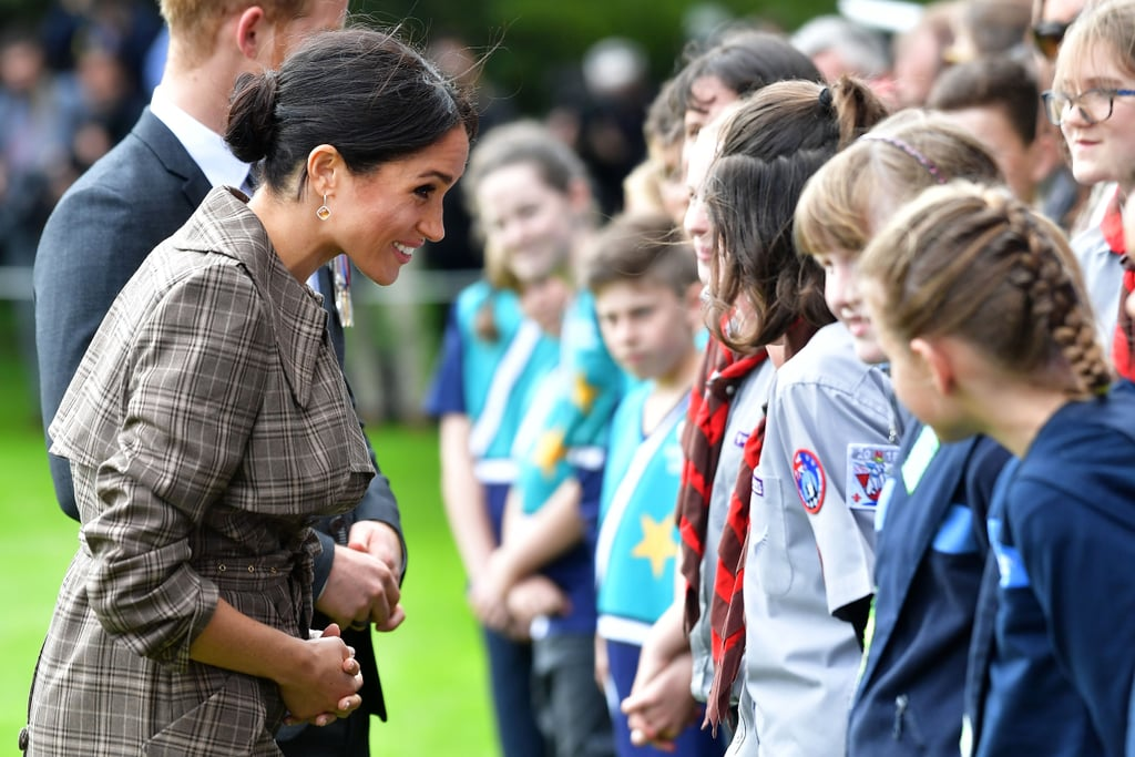 """Meghan Markle has had a ton of royally sweet moments during her 16-day tour of the South Pacific with Prince Harry. She's delivered powerful speeches, held her husband's umbrella, teared up at a hilarious children's song, and recently, spent time comforting a sobbing fan.  The royal couple touched down in Wellington, New Zealand, on Sunday, after saying goodbye to Australia and the Invictus Games. They first stopped at the Tomb of the Unknown Warrior at the Pukeahu National War Memorial, then greeted the crowds of gathered fans, much like their visit in Melbourne.  While saying hello to the masses, the duchess (and mom-to-be) was drawn to a crying teenage fan and reportedly spent """"quite a while"""" talking with her. """"One of the sweetest moments on the #royaltour so far!"""" tweeted reporter Natalie Oliveri. This isn't the first time during the tour that the royals have stopped to comfort an overwhelmed fan — Harry actually broke traditional protocol when a young woman burst into tears!  Check out more snaps of Meghan and Harry's interaction with fans in Wellington below. When it comes to royal walk-throughs, these two are seasoned pros now.       Related:                                                                                                           Meghan Markle Made a Rare Royal Move and Shared a Sweet Photo of Prince Harry on Twitter"""
