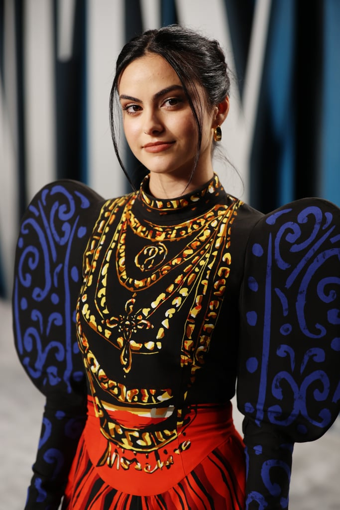 Camila Mendes was a walking work of art at Vanity Fair's annual Oscars afterparty. The actress, who was in attendance with several of her Riverdale costars, wore a dramatic dress from Moschino's Spring 2020 collection, which was inspired by Pablo Picasso.  A different silhouette for Camila, the dress featured oversize puff sleeves counterbalanced by a high-neck collar and formfitting bodice. The bold print was also apparently hand-painted before being digitally re-created for the runway. With its chunky necklace displayed squarely on the dress, there wasn't a need for many more accessories, although Camila did wear a pair of classic hoop earrings, a gold Le Vian ring, and ankle-strap, platform heels. See the artful Oscars outfit from all angles ahead.      Related:                                                                                                           After Seeing Lili Reinhart's Gown, We Think She Should Star in a Remake of The Princess Bride