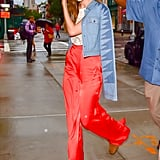 A bright pair of trousers added serious outfit interest and paired perfectly with Gigi's red shades.