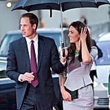 Prince William held an umbrella for Kate Middleton on their way into the April 2012 premiere of African Cats in London.