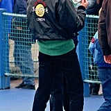 Spending the day with her sons at Thorpe Park, Diana's throw-on style included dark denim jeans, a green knitted jumper, and an enviable Hard Rock cafe leather bomber jacket.