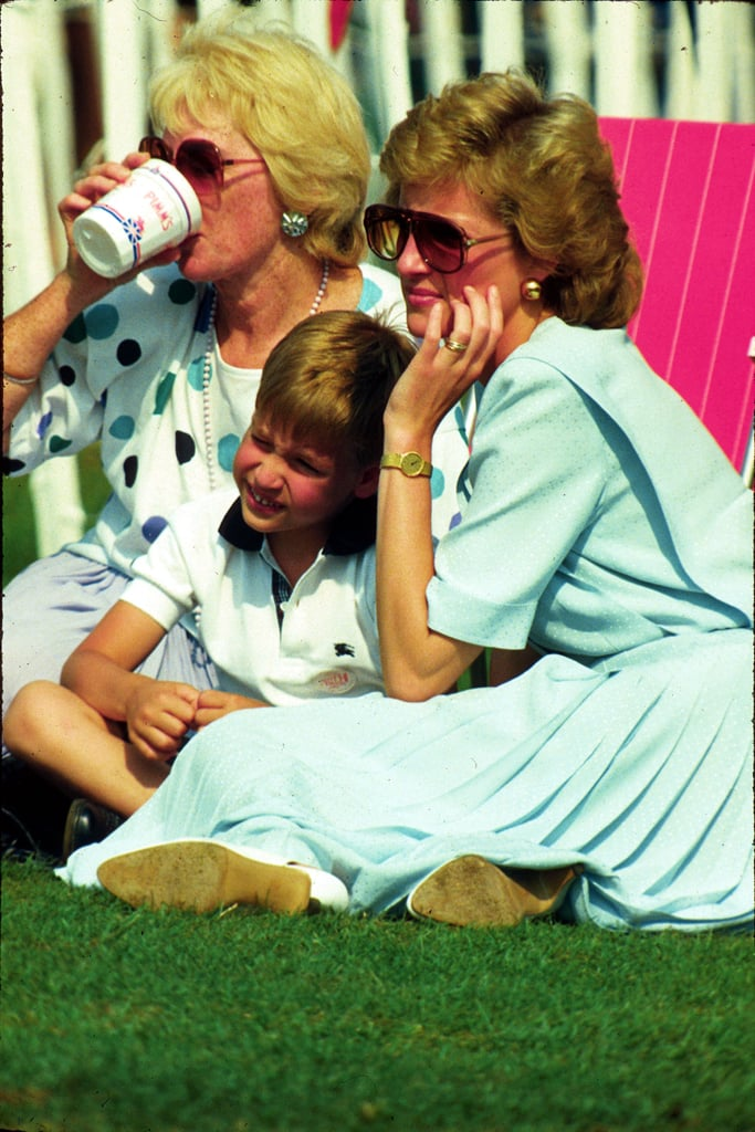Prince William cuddled into his mum's lap while watching a polo tournament in Windsor in 1989.