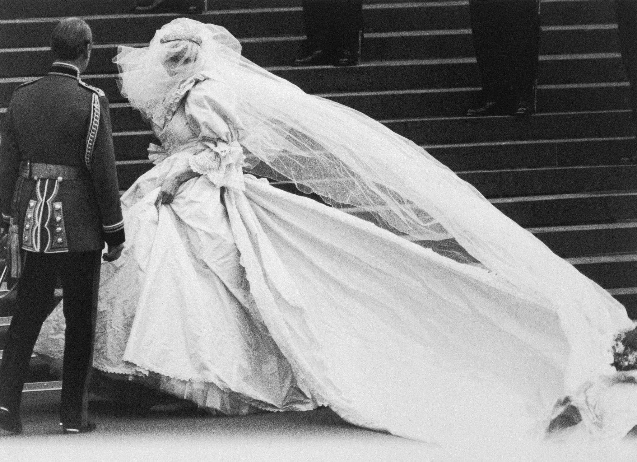 Lady Diana Spencer arrives at St. Paul's Cathedral on her wedding day, revealing to the world the wedding dress which had been carefully guarded during its design.