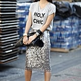 Holy chic is right — we love the juxtaposition from a great t-shirt to a glam, metallic skirt. Source: Greg Kessler