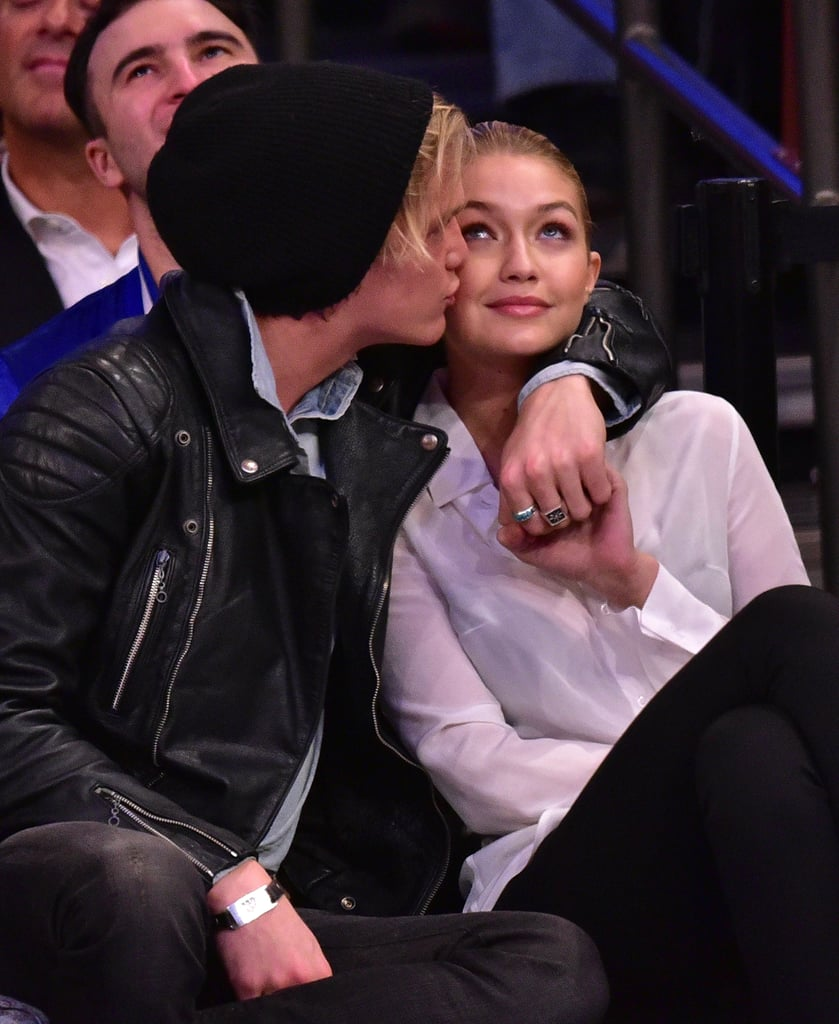 """Model Gigi Hadid got animated at Wednesday night's Knicks game against the Nets, standing up to cheer before sitting and snuggling up to her other half, singer Cody Simpson. The cute couple laughed and chatted throughout the game, exchanging kisses and flashing big grins in their front-row seats. This isn't the first time they've shown sweet PDA, though; both Gigi and Cody regularly post adorable pictures of each other on social media, and Gigi's mom, Real Housewives of Beverly Hills's Yolanda Foster, called them the """"next generation of love and romance"""" in their family. Check out Gigi and Cody's cutest moments in pictures, then see Gigi's hottest Instagram snaps and her fitness routine!"""