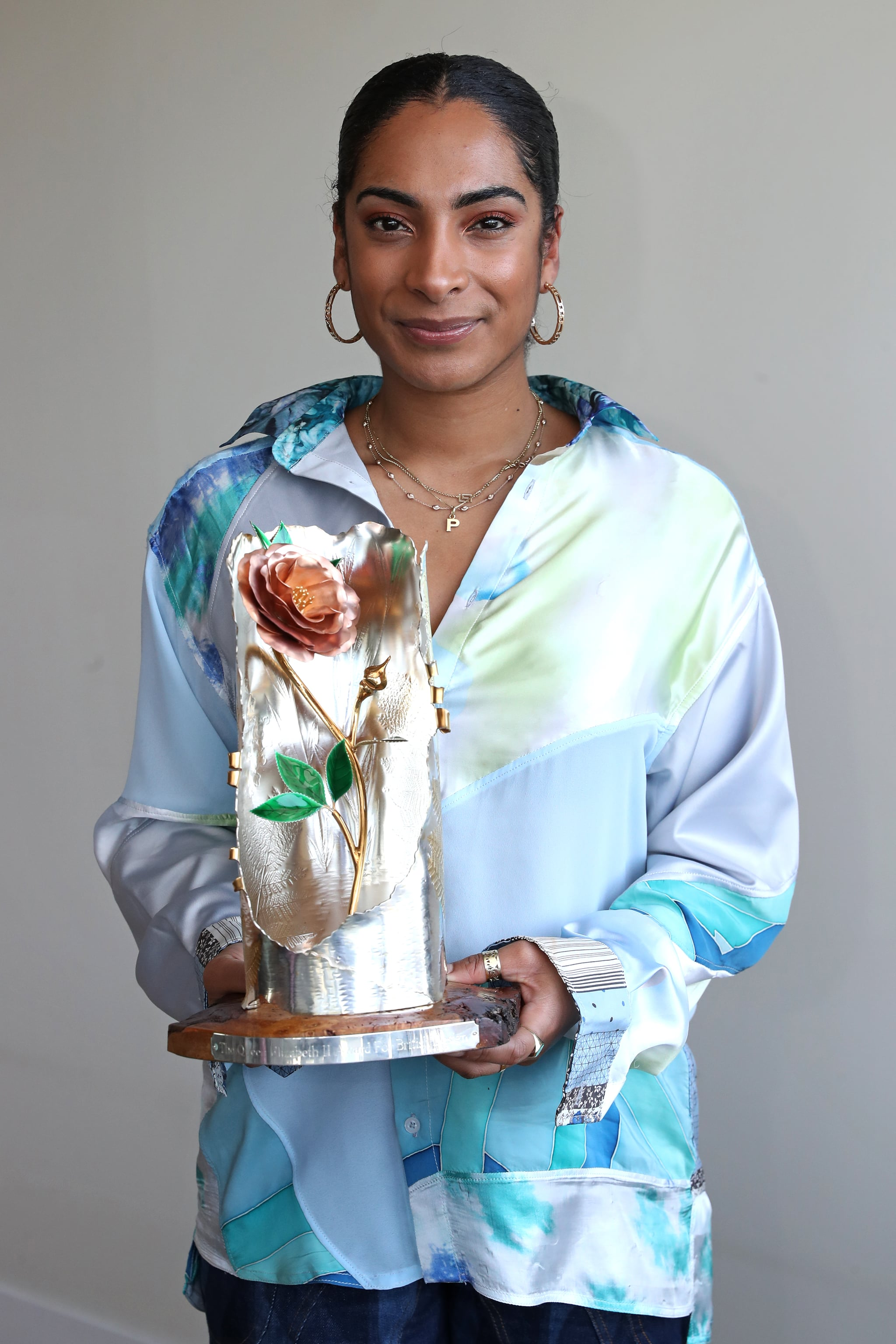 LONDON, ENGLAND - FEBRUARY 23: Winner of the Queen Elizabeth II Award for British Design, Designer Priya Ahluwalia is pictured with her award during LFW February 2021 at Fora, Soho on February 23, 2021 in London, England. (Photo by Chris Jackson/BFC/Getty Images)