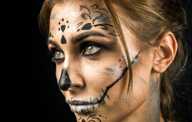 Beautiful woman with halloween make up posing isolated on black background. Close up, copy space.; Shutterstock ID 1208058904; Job: -