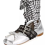 """""""Thankfully Fashion's obsession with flats continues into the Fall, and Miu Miu's Belted Ballerina Flats ($620) come with a statement-making design that makes even your beat-up boyfriend jeans look infinitely more stylish. Sign me up!"""" — HWM"""