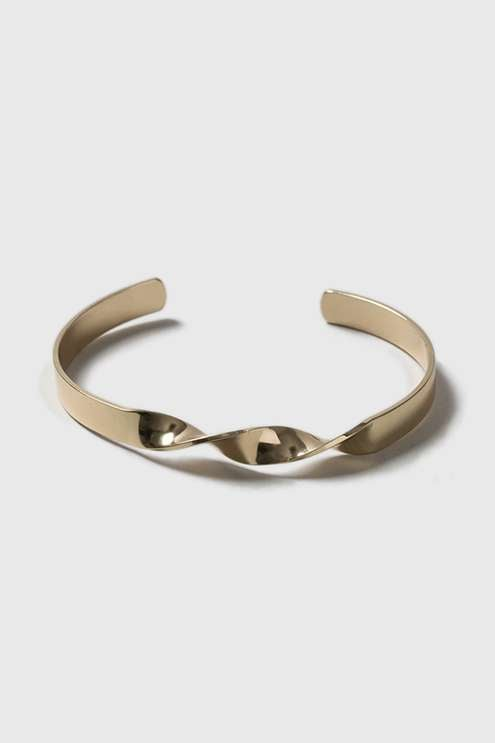Make it an arm party with this gold twist bangle ($14).