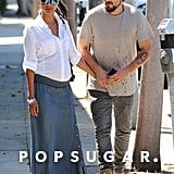 Zoe Saldana hid her baby bump during her Thursday afternoon with husband Marco Perego in LA.