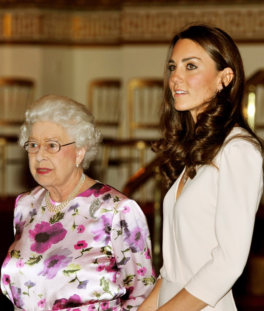 The Queen and Kate Middleton viewed the exhibitions for the Summer opening of Buckingham Palace on July 22, 2011 in London, England. Kate's wedding dress was one of the items on display.