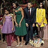 The Obama family get ready to meet the little elves at this year's Christmas in Washington gala.