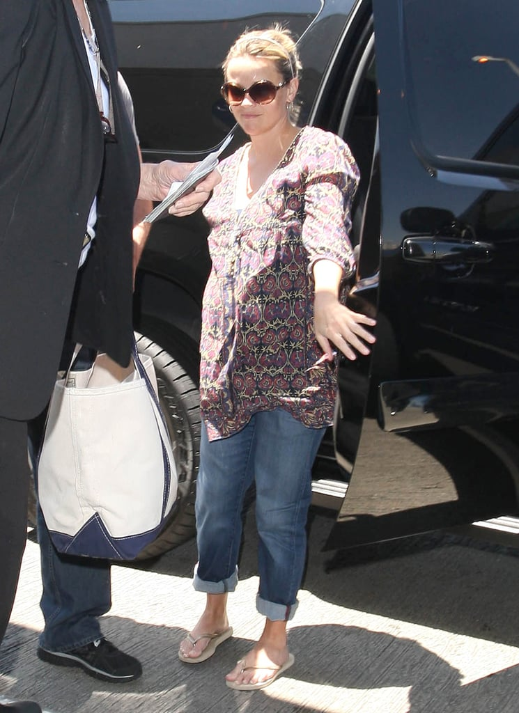 Reese Witherspoon stepped out of an SUV before heading for an airplane.