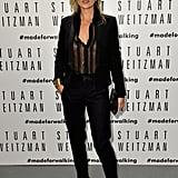 A sheer pin-striped shirt and black trouser suit were Kate's choices for the opening of the Stuart Weitzman store in Milan, Italy.
