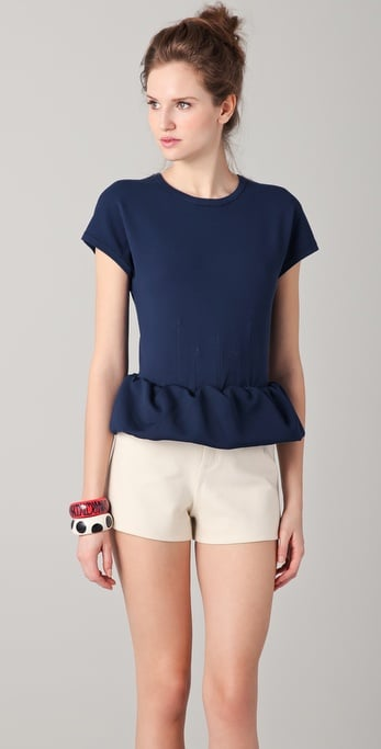This short-sleeved, scoopneck sweater combines two of our favorite Spring trends — bold navy blue and a peplum hem.  Marc by Marc Jacobs Luca Sweater Top ($258)