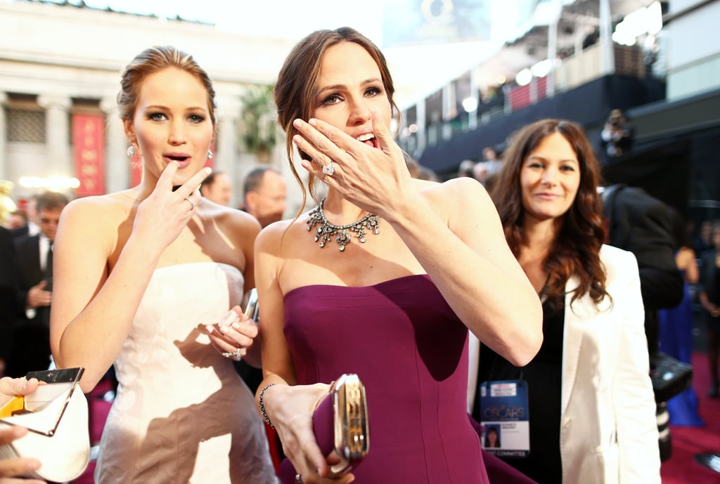 Jennifer Lawrence and Jennifer Garner flashed hand signs on the red carpet.