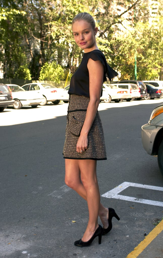 For a 2003 Toronto International Film Festival photocall, Bosworth went prim and proper in a tweed high-waisted skirt and ruffled black blouse.
