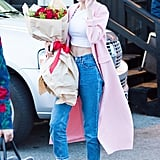 On her birthday, Gigi broke out her pink duster coat to match her Gucci fur loafers.