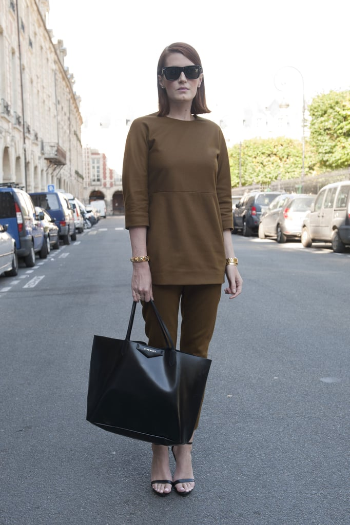 Simply chic, from her monochromatic look to her Givenchy tote.