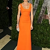 Cameron Diaz wore an bright orange Victoria Beckham gown paired with a silver clutch and dazzling bracelet.