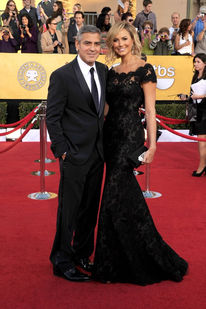 George Clooney and Stacy Keibler were together this evening on the red carpet at the SAG Awards in LA. She was decked out in a black dress from Marchesa, matching boyfriend George in his black and white tux. Stacy took a night off from award season craziness on Saturday, when she skipped the Directors Guild of America Awards. George was there to honor his The Descendants director Alexander Payne along with costar Shailene Woodley. This evening could bring more honors to Alexander's movie if George walks away with a best actor statue. They're also in the running for best performance by an ensemble cast.