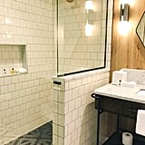 The bathroom is also a stylish haven, from the marble vanities to the mosaic floor tiles.