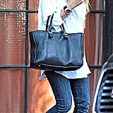 Mary-Kate Olsen perfected the classics with dark denim, a structured tote, and a white button-down.