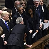 George W Bush Gives Michelle Obama Candy at Father's Funeral