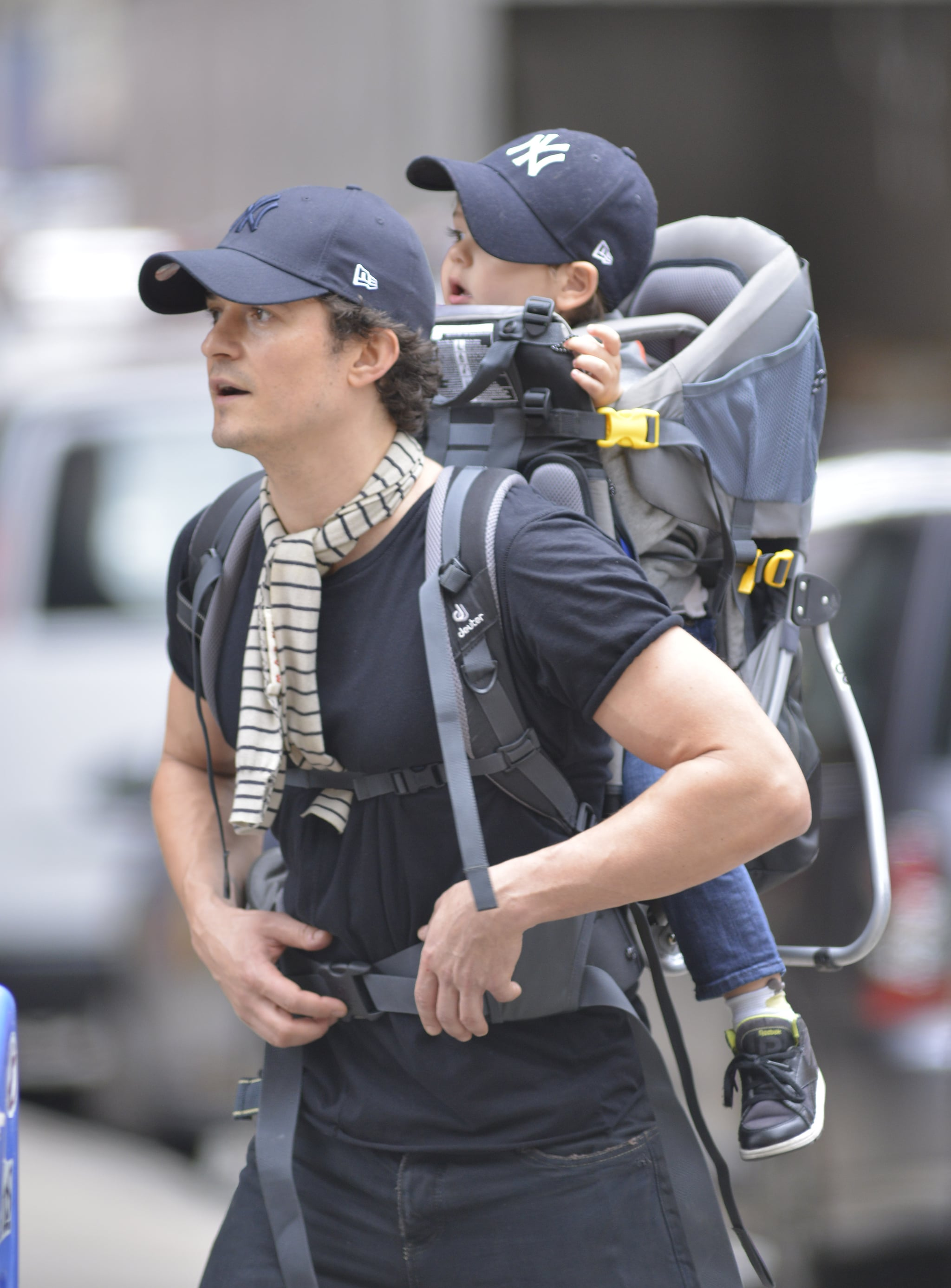 Orlando Bloom carried his son, Flynn, on his back while out in NYC.