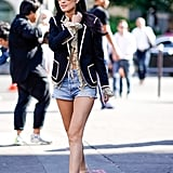 Wear Your Denim Shorts With a Blue Blazer and Beige Sandals