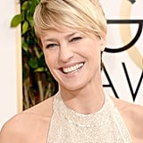 Robin Wright's smile brightened the red carpet like a ray of sunshine. A nude lip and effortless pixie cut rounded out her look.