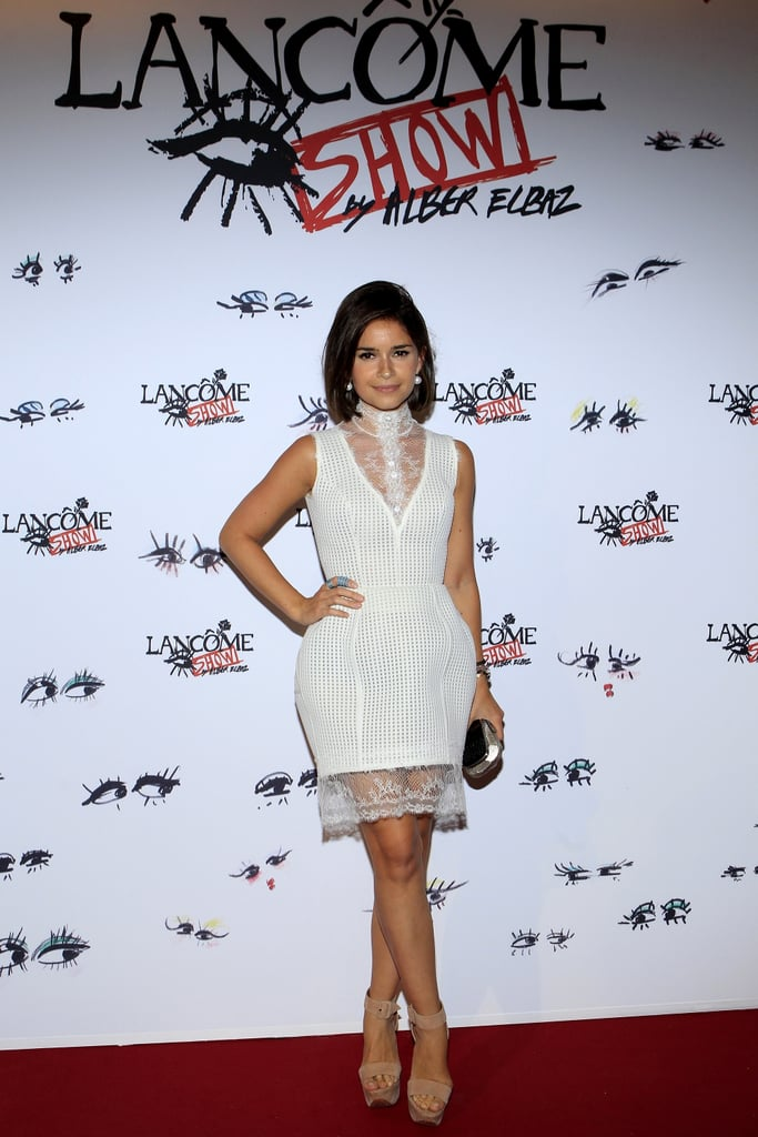 "Miroslava Duma defined ""white hot"" while working her lacy design at the Lancome Show by Alber Elbaz party. Source:  Stéphane Feugère for Lancome"