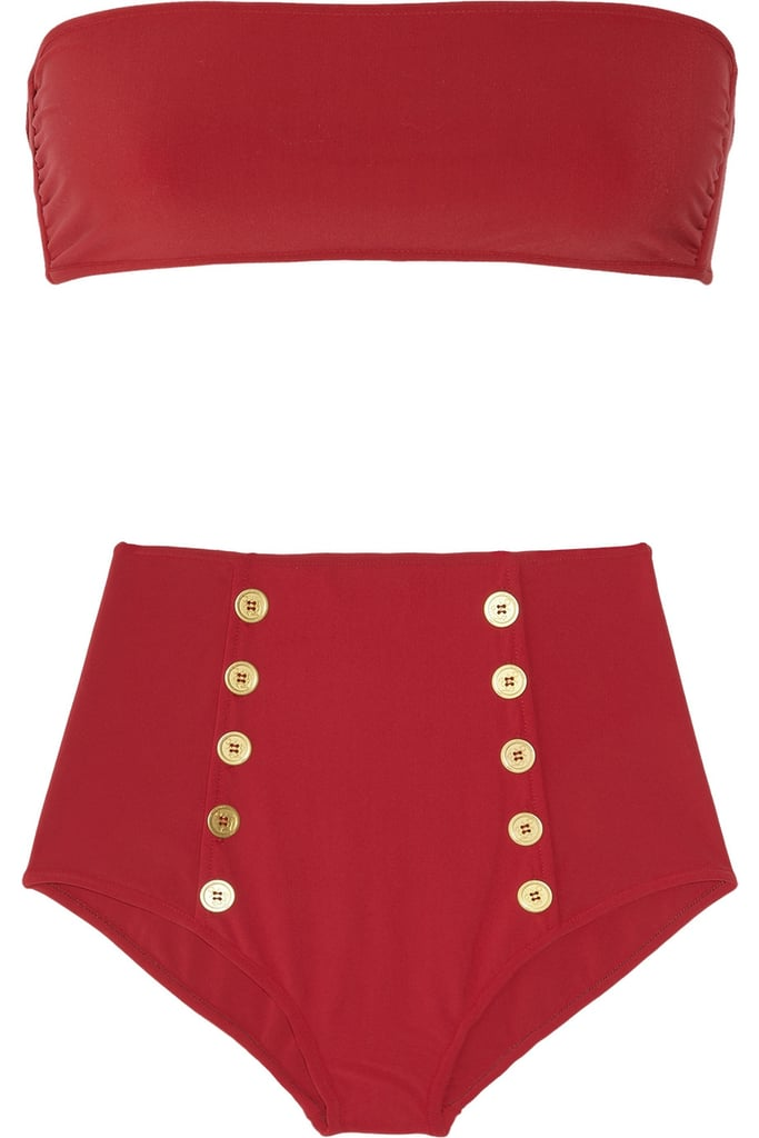 Sexy and nautical, this bandeau two-piece can easily be mixed and matched with your other swim pieces.  Yves Saint Laurent High-Waisted Bandeau Bikini ($525)