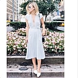 A deep V-neck dress looks casual yet clean completed with a pair of white pointed flats, whereas heels might overdo it. Source: Instagram user damselindior