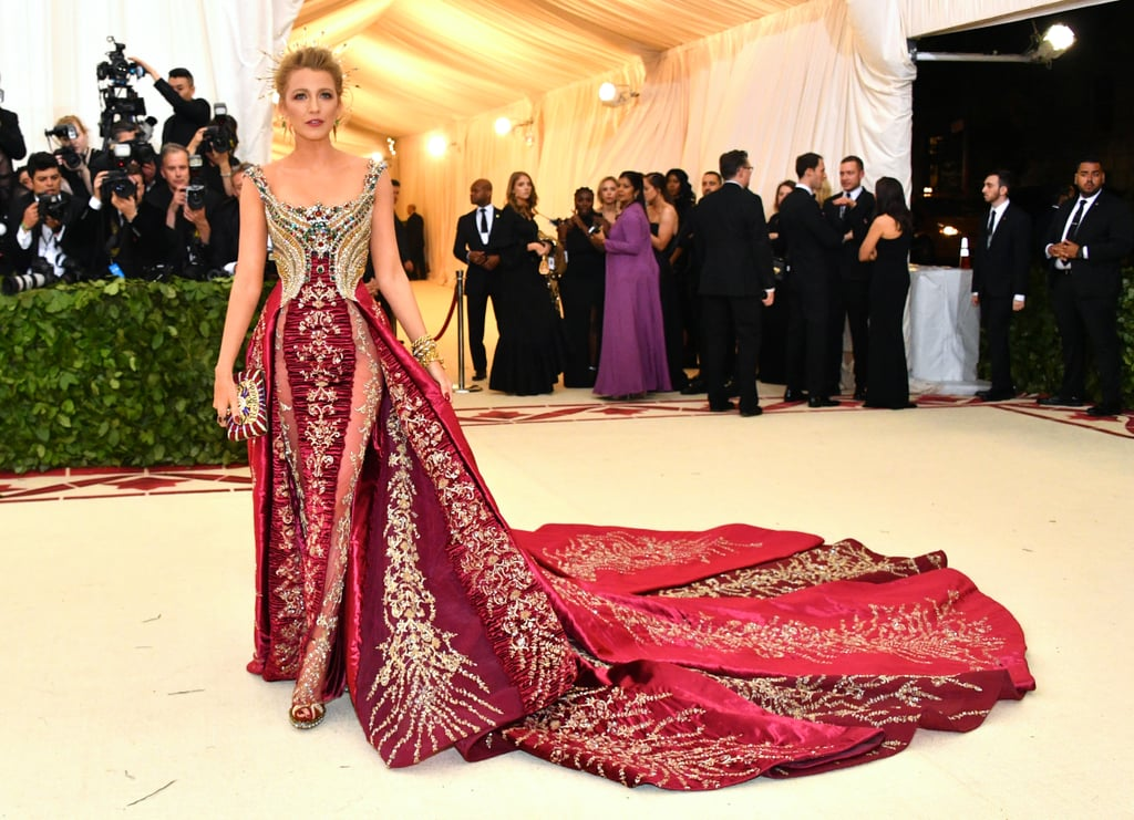 "Step 1: Freak out over Blake Lively's insanely glamorous Met Gala gown. Step 2: Take a breather and bask in the gorgeousness that is her regal beauty, and see if you can handle it better than the photographers at the Met Gala could. Step 3: Go on with your day and try to accept that even though Blake Lively didn't bring hubby Ryan Reynolds as her date, she made up for it with every single detail of her outfit being on-theme.  OK, now, take a step back and prepare to have your mind blown, because it turns out that the Met Gala veteran actually did bring Ryan with her, and not only him, she brought the whole family right in the palm of her hand! For the ""Heavenly Bodies: Fashion and the Catholic Imagination"" theme, Blake carried a custom Judith Leiber handbag emblazoned with a ""Reynolds"" family crest matching perfectly to her Versace gown.  If you look a little closer you can see the initials B, R, J, and I, for Ryan and their daughters James, 3, and Ines, 1. Yep, it doesn't get any sweeter than that, and we can't believe the subtle family tribute almost slipped right past us. Read on for a closer look at the heartwarming bag."